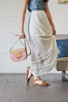 Milky raw skirt and woven sandals.
