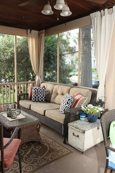 Screened-in porch...loving the trunk next to the couch.  I could paint my old one and use it as a side table.