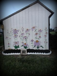 Gave my shed a fun look with a mural of flowers. I invited 10 of my mom friends over and everyone painted a flower. I cannot wipe the smile off my face as I sit on my deck and look at the end results and think of the great fun we had doing this project.