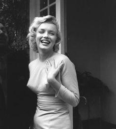 American film star Marilyn Monroe (1926 - 1962) outside her home at Englefield Green.