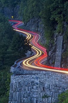Amazing use of slow shutter speed by capturing cars distinctive lights, winding down roads. This image is also taken from a perfect angle to reveal a distorted, life like shape. Slow Shutter Speed Photography, Light Trail Photography, Light Painting Photography, Night Photography, Digital Photography, Sport Photography, Photography Camera, Photography Tutorials, Landscape Photography
