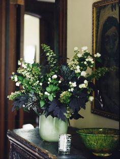 Dark greenery and white glowers.