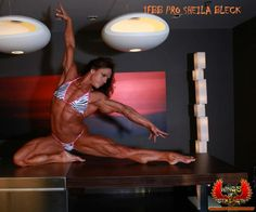 IFBB Pro Sheila Bleck posing her lovely physique for Wings Of Strength!