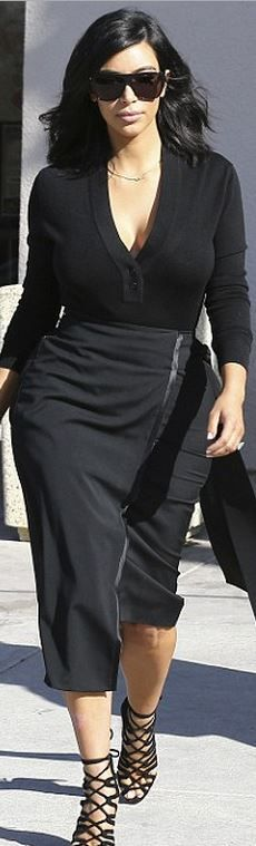 Kim Kardashian's black sunglasses, lace up suede sandals, and long sleeve top style id