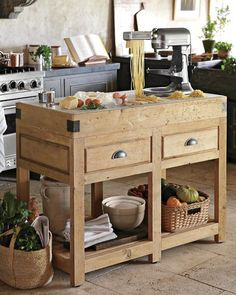 Williams-Sonoma Reclaimed Pine & Marble Kitchen Island  http://www.williams-sonoma.com/products/reclaimed-pine-marble-butcher-block/?catalogId=99&cm_src=AutoRel