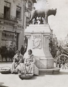 Young women sit underneath a Capitoline Wolf sculpture in Bucharest Wolf Sculpture, Gypsy People, National Geographic Images, Romanian Girls, City People, Bucharest Romania, Gypsy Life, My Town, Old City