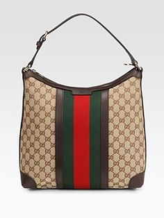 Gucci - classic with a modern twist. Love the shape of this bag. I love the classics