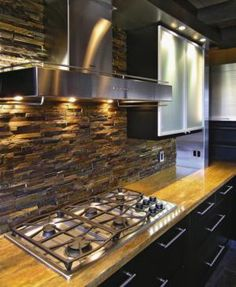 rustic modern kitchen. Love the backsplash with stainless steel appliances.