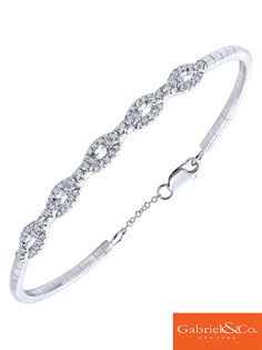 The perfect 14k White Gold Diamond Bangle by Gabriel and Co. Such a gorgeous  elegant bracelet to go with any wedding dress.
