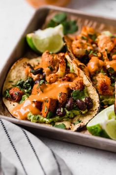 an easy vegetarian tacos recipe filled with easy roasted cauliflower, roasted sweet potatoes, black beans, topped with vegan chipotle lime cashew crema. these roasted sweet potato + cauliflower tacos are totally weeknight-friendly, made in 40 minutes or less, making this the perfect vegetarian taco recipe for taco tuesday!