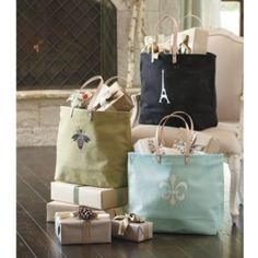 These French-inspired icon totes are on sale from Ballard Designs. Only the Eiffel Tower is still available. I'm a fan! Decorative Accessories, Home Accessories, French Icons, French Chic, Candle Wall Sconces, Ballard Designs, Cute Bags, Leather Handle, Paper Shopping Bag