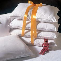 I love pillows.  I sleep with five.  It's not home unless they're piled high. :)