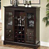 Found it at Wayfair - Yates Wine Cabinet. SO hot right now!