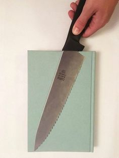 She lays a large kitchen knife on top of a book for genius kitchen storage @nastoll5 this made me think of you.