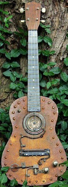 Steampunk Tenor Ukulele (may even be a Baritone but its a nice decoration job) --- https://www.pinterest.com/lardyfatboy/