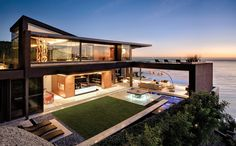 The clients, a British couple living in Cape Town, requested a six-bedroom, seven-level home that makes the most of the site, the views and the mountain. The...