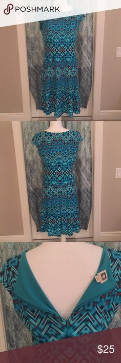 """Anne Klein dress. Size 10. Absolutely beautiful Anne Klein dress, Size 10, in turquoise, blue, with red accents. Little cap sleeves. Never worn, just tried on. Chest measurement is 18"""". Waist is 16"""". Hips are 18.5"""". Fabric is stretchy. Length from armpit to bottom is 32"""". Anne Klein Dresses"""