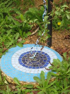 stepping stone at base of upcycled kettle
