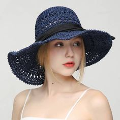 f93a2858f50bf Hollow Hand crochet straw hat with bow UV beach womens wide brim sun hats