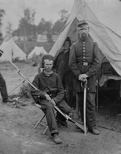 Captain Harrison H. Jeffords, of the 4th Michigan, with a young unidentified private. Photo from the National Archives Collection #civil #war