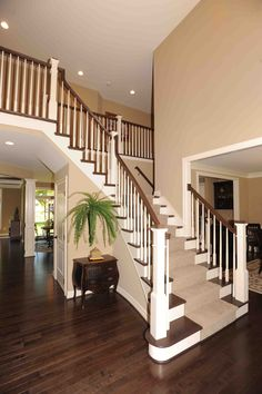Lastest Home Design. Getting Bored With Your Home? Use These Interior Planning Ideas. There are many simple ways to learn about decorating your space. Stairway Decorating, 2 Story Foyer, Getting Rid Of Clutter, Pantry Design, Living Spaces, Living Room, House Stairs, Stairways, Hardwood Floors