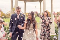 Flower petal confetti at Froyle Park wedding photographs. Photography by one thousand words wedding photographers