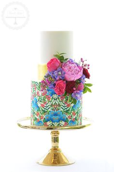 Stunning wedding cake using an edible image design used on the couple's invitations