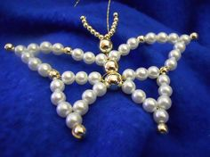 Butterfly by HandcraftedOrnaments on Etsy Materials: 8mm gold bead, 26 gauge wire, 6mm japanese pearl beads, 3 mm japanese pearls gold beads