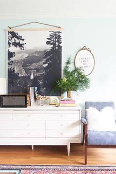 Decorating is all about telling stories. So why don't you put a chair with a nice woollen pillow or sheep skin next to your misty mountain print? Looks like a cloud came by to say hi.