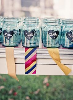 15 Ways to Use Mason Jars at Your Wedding - DIY escort cards with chalkboard paint.