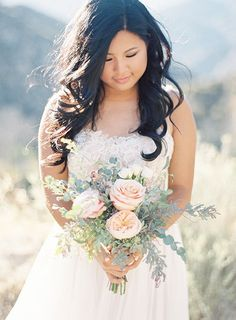 Bride in Strapless Watters Wedding Dress with Blush and Pink Bouquet | Brides.com