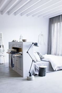 white and grey wood bedroom. Nice simple trunk nightstand (want one!)