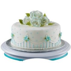 Blossoms in Blue Cake  http://www.wilton.com/idea/Blossom-in-Blue-Cake