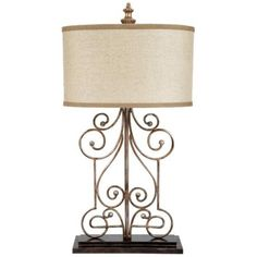 """Burlap And Iron Gate Table Lamp -   Spruce up a console or nightstand with this sophisticated and traditional table lamp. The base features an iron gate-like design with scrolling details. A burlap drum shade tops the design for a look that is both clean and stylish.      Traditional style table lamp.     Iron construction.     Aged finish.     Burlap shade.     Rotary switch.     Takes one 150 watt 3-way bulb (not included).     31"""" high.     Shade is 16"""" wide, 9 1/2"""" high."""