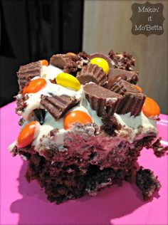 Reese's Poke Cake- Use up leftover Halloween candy on top of this easy poke cake. It's as good as it looks!