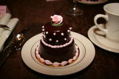 2 tiered chocolate mini cake with pink rose