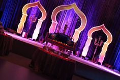 Check-out our Aladdin-inspired Wedding Reception backdrop. From regal lanterns, to traditional surahis, to the popular mehrabs.it was a magical night to remember! Aladdin Play, Aladdin Broadway, Aladdin Musical, Arabian Theme, Arabian Party, Arabian Nights Theme, Aladdin Arabian Nights, Arabian Nights Wedding, Wedding Night