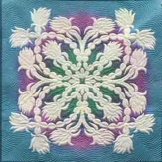 Hawaiian quilt. Lovely colors, wonderful stitching