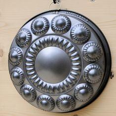 Bakblik in de vorm van een Zeeuwse knop.