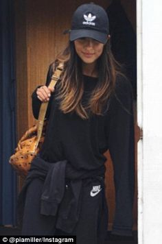 Hit the gym: Activewear has had an update! Channel Pia Miller's relaxed luxe look (left). Model wears cap ($10) black jacket ($XX) and leather bag ($129.95) all at TK Maxx