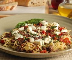Tomato-Basil Pasta: must try pasta dish using Laura's Lean Beef for a high protein but lean meal! You can use whole wheat pasta.