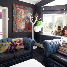 Living Room - Dark charocal Resene Cod Grey walls looks great with colourful accessories.