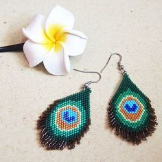 Peacock Earrings - Delica bead #aiedailgallery #indonesian #beadartist #handmade #beadjewelry #beadweaving #brickstitch #peacock #earrings #miyuki #delica