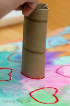 8 Heart-tastic Crafts for Kids: Cardboard Roll Heart Stamp