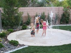 Forget the pool - build a backyard splash pad instead! Pad of concrete, with fountains and water jets underneath. Awesome!!!