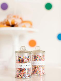 "A perfect parting gift for the guests are small jars filled with the same colorful sprinkles used throughout the party. Add sprinkles to a cute glass jar and attach a ""Sprinkled with Love"" label."