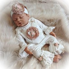 Welcome your little one home in this adorable ruffle romper. The romper features Ivory sequin and beaded lace trim and a fabulous mocha satin flower. Such a unique outfit for your special little lady. Perfect for those first photos.  The optional headband completes the outfit.  Each of these