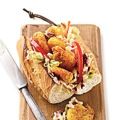 Crusty, well-toasted bread; crispy pan-seared shrimp; and crunchy slaw make this sandwich worth every bite.