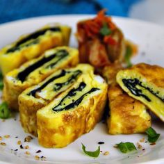 (Use 3 egg whites, and cook in a nonstick pan instead of oil) Korean Rolled Omelette with Roasted Seaweed (Gyeran Mari w/ Gim) is delicious for breakfast, lunch in a bento box, dinner over salad, or as a snack (serves 1 for a meal, 3 for snack). The seaweed rolled into the middle gives this egg dish bite and a little bump of flavor.