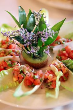 This cold appetizer has a great flavor. The ingredients are quite simple and you just need a homemade salsa and some endive to make it. One of the most special things about this appetizer though is its beautiful garnish. You can be creative with garnishes and use your own ideas to make something really spectacular.